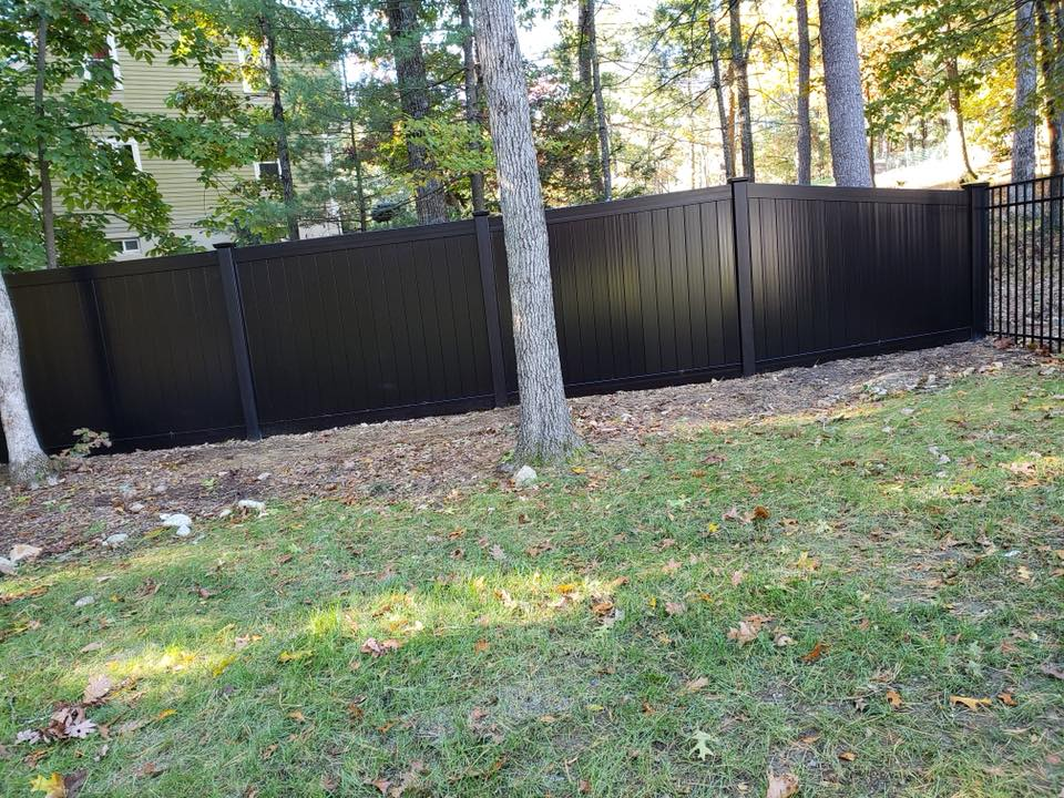 Black wood fence installation