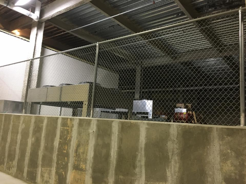 Security chain link commercial fence installation